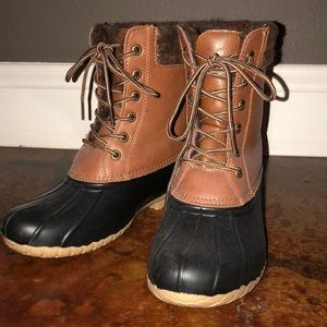 Tan and brown duck boots